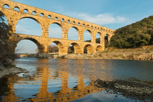 Photo of an aqueduct used in ancient water treatment infrastructure.